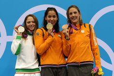 Silver medallist Aliaksandra Herasimenia of Belarus, gold medallist Ranomi Kromowidjojo of Netherlands, and bronze medallist Marleen Veldhuis of Netherlands