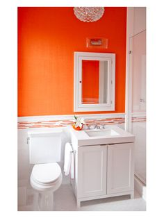 Orange for the vanity, white mosaic floor, white marble top, polished chrome faucets...could be fun fun fun!