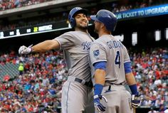 Royals keep rolling - The Kansas City Royals' Eric Hosmer, left, bumps chests with teammate Alex Gordon after Hosmer hit a solo home run during the second inning against the Texas Rangers on May 12. The Royals won 7-6 in 10 innings. - © LM Otero/AP