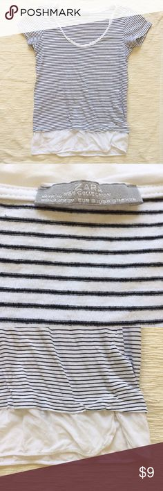Zara striped tee Black and white striped tee with faux shirt attached to the hem. Has a cute split on the front. Size small. See tag for Euro sizes. Zara Tops Tees - Short Sleeve