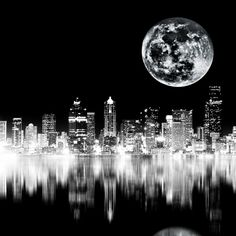 I like the mood in the corner but i dont like the reflection if the city because it being blurred with the skyline it looks like its to chaotic. The reflection should also be at a lower opacity Black And White City, Black And White Pictures, White Art, Stars Night, Cool Photos, Beautiful Pictures, Tres Belle Photo, City Photography, Seattle Photography