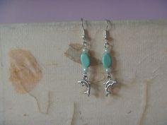 Items similar to dolphin dangle earrings, OOAK ecofriendly dolphin drop earrings on Etsy Leaf Earrings, Silver Earrings, Dangle Earrings, Turquoise Beads, Turquoise Bracelet, Beaded Lanyards, Hand Jewelry, Free Silver, Dangles