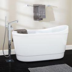 "55"" Emeigh Acrylic Freestanding Tub from signature hardware Starting at $1,139.95 •  Shape: Oval  •  Length: 55""  •  Width: 28-1/2""  •  Height: 31-7/8"""