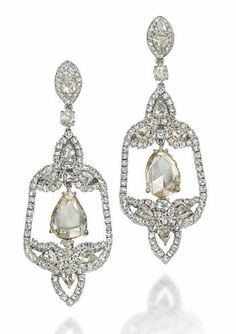 A PAIR OF DIAMOND EAR PENDANTS, BY CARNET Diamond-set throughout, each openwork bell-shaped panel with trefoil design rose-cut diamond terminals, suspending a pear-shaped rose-cut diamond drop centre, with marquise-shaped similarly-set surmount
