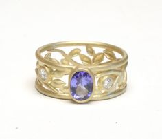 Tanzanite and 18K Gold Ring by Natasha Wozniak. The tanzanite was liberated from a dull ring that was never worn and made into a ring with a classical and Art Nouveau influence.