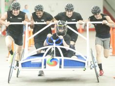 Kentucky Derby Festival: Bed Races - the team of Alpha Energy Solutions crosses the finish line with the fastest time of the day, 33.41 seconds,
