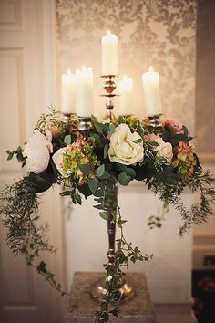 Luxurious Tall Candelabra Wedding Centerpiece With Candles Candelabra Wedding Centerpieces, Candelabra Flowers, Table Flowers, Flower Centerpieces, Wedding Decorations, Centrepieces, Wedding Ideas, Wedding Flower Arrangements, Floral Arrangements