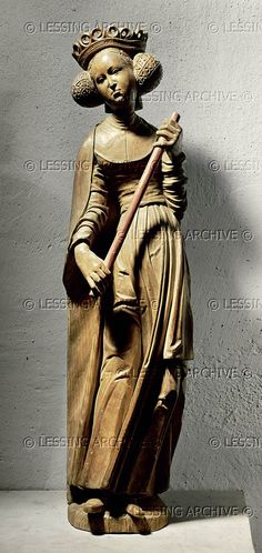Saint Ursula with crown and staff. Last remaining figure from a Gothic altar. Wooden statue