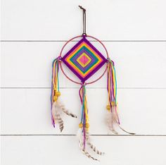 wide Handmade God's Eye Dream Catcher with yarn middle and fabric wrapped hoop. Embellished with ribbon, suede, feathers and beads. Makes a perfect gift!