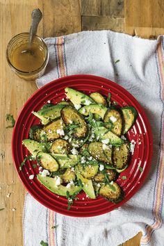 """In the 1930s, artists Diego Rivera and Frida Kahlo often hosted festive dinner parties—which Frida called """"día de los manteles largos,"""" the days of the long tablecloth—at their Mexico City home. The recipe for this simple Mexican salad of grilled zucchini, avocado, and salty, crumbled añjeo cheese lightly dressed in a vinaigrette, was served at a dinner party attended by Mexican composer Carlos Chávez and Nelson Rockefeller."""