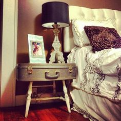 Attach a vintage suitcase to the legs of an old side table or chair to make a cute nightstand