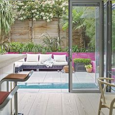 Miami vibe in a UK garden. The hot pink works great with the green plants.