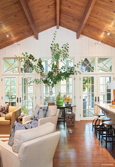Living room with vaulted wood ceiling.