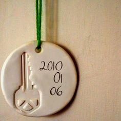 Ornament of the first home key you had as a family ♡