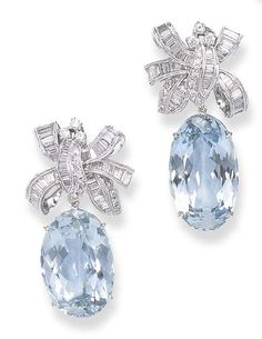 A PAIR OF AQUAMARINE AND DIAMOND EAR PENDANTS. Each detachable oval-cut aquamarine pendant suspended from a circular and baguette-cut diamond ribbon bow, mounted in white gold.