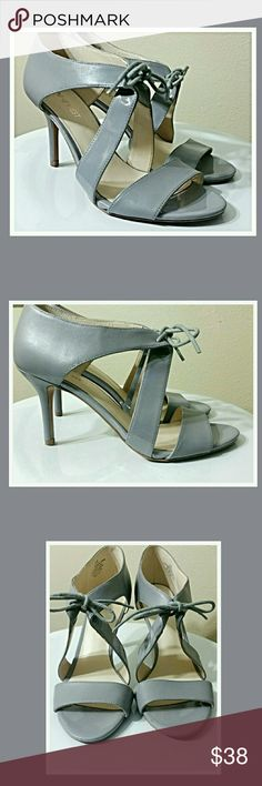 Grey Heels....NWOT....size 7.5 1 Shiney strap and the rest matte leather grey Nine West Shoes Heels