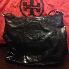 Tory Burch Handbag - 1 day sale 100% authentic Tory Burch black leather handbag with gold metal hardware. With original dust bag. Very roomy instead. With mirror still attached and tap still on. Purchased from Nordstrom for $699+ tax. Don't have the tag. No trades/no refunds/no exchanges. Used gently. In good condition.  Dimensions : about length 14 inches x width 5 inches x height 13 inches. Tory Burch Bags Shoulder Bags