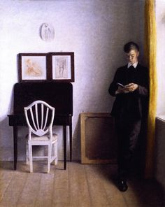Interior with man reading - Vilhelm Hammershoi