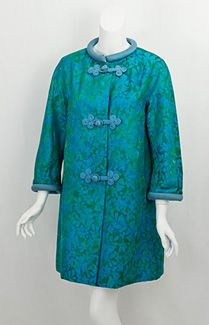 Christian Dior-New York satin brocade coat, 1960s. The stylish coat was made from luminous teal-and-olive brocaded satin, whose brilliant hue is even more dazzling up close. While not couture, the chic coat has superb construction and finish, as expected from a top couture house. The three-quarter-length sleeves would be perfect with long gloves or vintage costume bracelets.