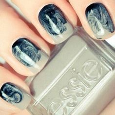 Swirled putty grey French tips - swirled into a deep navy blue base. You can create this by doing your base first - let it dry, then do a clear topper - before it's dry apply your tip shade and swirl that into the clear topper down from the French Tip you created.