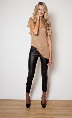 leather leggings- with a big white shirt and black motorcycle boots.