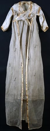"""Ensemble of """"mousseline"""" ivory white silk, embroidered with silver metallic thread, composed of two parts: overdress with sleeves and underdress. Early 1800s. (View 2)"""