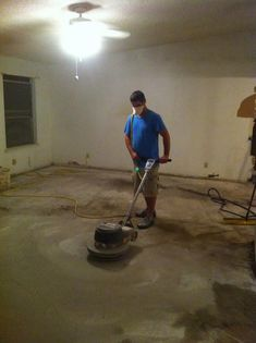 Step-by-step DIY process for stained concrete living room floors from Life We Live 4 (@Laura : Life We Live 4) with the help of tools rented from Home Depot.