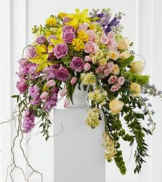 Lavender roses, yellow stock, pink stock, pink tulips, yellow roses, pink roses, pink spray roses, lavender larkspur, Bells of Ireland, yell...