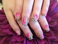 Acrylic nails with leopard freehand nail art and one stroke flowers