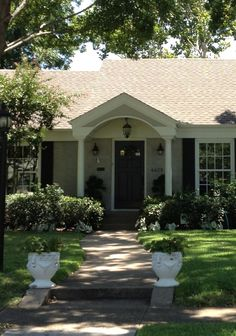 Love the shape of this porch (angled roof, curved interior, hanging lantern) but I'd use square columns.