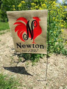 Rooster Monogram Burlap Garden Flag–measuring approximately 12X15 inches, this bright and cheery rooster garden flag will surely add a pop of color to your garden or country home!  Made of natural jute burlap and high quality heat transfer vinyl, this flag will wear for many years.  The flag is hemmed at the bottom and has a 2 inch rod pocket at the top, with seams down both sides to control fraying.  Embellished with your monogram, you will have a beautiful unique welcome to your home