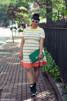 LOVE the dress with sneakers plus the clutch is amazing!
