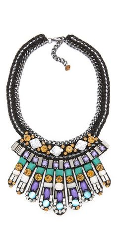 A what not to wear necklace. Big necklaces look junky, especially if their cheap to begin with. If you want the full necklace look go for multiple more delicate necklaces or 1 better quality piece you love paired with cheaper pieces of jewelry. As a rule don't do more then 4 necklaces or they will start to look junky