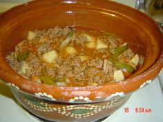 ' Picadillo Con Papas' Ingredients: ·2 pounds lean ground beef ·3 small potatoes-with or without skin, cut into ¼ or ½ inch cubes ·1 can tomatoes sauce -8 oz can ·1 med diced tomatoe ·1/2 small clean sliced bell pepper ·1/2 small sliced or finely diced onion-preferably white, ·1/4 cup cilantro, coursed or chopped ·1 teaspoon 'authentic mexican seasoning' 1 teaspoon salt (or to taste) ·1 ½ cups to 2 cups water