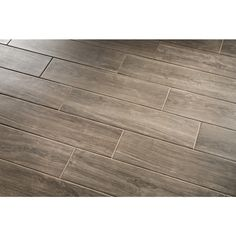 Metro Wood Walnut Glazed Porcelain Floor Tile 6-in x 24-in - to be laid in a wood floor pattern NOT brick pattern. $2.48 each - laid according to layout provided. GROUT - UNSANDED CUSTOM WALNUT CIRCA