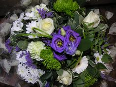 Beautiful hand tied bouquet in greens,purples and whites