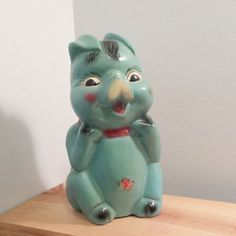 Super cute 10 inch tall vintage aqua blue Chalkware Piggy Bank. For Sale by DanushasCollectibles vintage Etsy Shop.   https://www.etsy.com/listing/239363877/vintage-chalkware-piggy-bank-turquoise