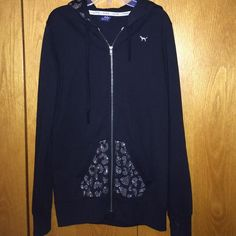 Black Victorias Secret PINK Zip Up Hoodie This hoodie is black with silver gems. No gems are missing. The front pocket and back hood are cheetah with silver gems. Lightly worn. PINK Victoria's Secret Tops Sweatshirts & Hoodies