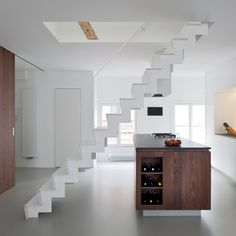 Lovely, but... stairs are too step, and the handrail doesn't start low enough. When form is placed before function, you can be sure users won't feel comfortable on these stairs.