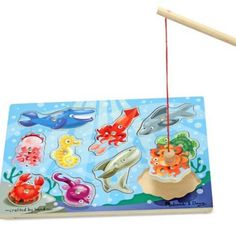 Here fishy, fishy! This magnetic wooden puzzle game features 10 fun and colourful aquatic animals. Use the magnetic fishing pole to 'catch' them the enjoy the challenge of returning them to the depths. A creative way to encourage hand-eye coordination. Play Therapy Techniques, Therapy Games, Melissa & Doug, Wooden Puzzles, Fine Motor Skills, Card Games, The Book, Fishing, Target Practice