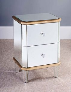 Mirrored bedside table with drawers provides enough space for storing what you need.