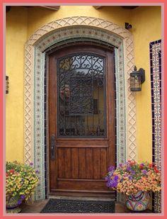 Tierra y Fuego tiles surround this front door entry. Entry Tile, Entry Doors, Front Doors, Entry Way Design, Foyer Design, House Awnings, Spanish Exterior, Spanish Courtyard, Hacienda Homes