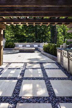 Here's a great entertainment outdoor space with a full outdoor kitchen and a seating area with a fire pit. For this landscape project, the Graphix wall was used for the back wall and the fire pit to create a 3-D effect. The Borealis wall (a faux-wood concrete stone) was used for the island. For more landscape ideas, visit our landscape stones at www.techo-bloc.com. #patio #backyard #retainingwalls #landscapesteps #landscapestoneedging #modernyardfirepits