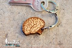 Laser cut and engraved brain wood keyring. $12.00, via Etsy.