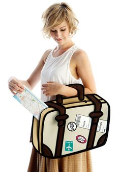 A travel bag that looks like a drawing from Jump From Paper. Another one of these 2D bags