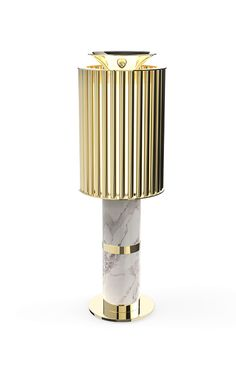 Delightfull | Donna table is a elegant piece made with a patterned composition of straight brass tubes with irregular shades of the Estremoz white marble. The warm light passing through the golden tubes makes every sitting room cozy and charming. #midcenturymoderntablelamp #eleganttablelamp #marbletablelamp Find more here: http://www.delightfull.eu/en/heritage/table/donna-desk-lamp.php