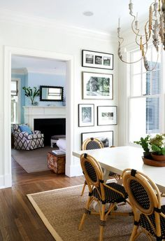 Fill a vertical space. Have a narrow slice of wall to fill? Hang art in the space all the way from the floor to the ceiling. You could do this on a large wall, but this is a great way to try out a dramatic gallery-style wall without making such a big commitment.