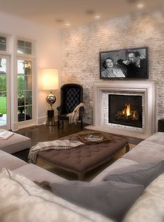 This softly lit neutral Hollywood Chic living room looks like something from a dream (via John Kraemer & Sons) - Decoration for House Chic Living Room, Home Living Room, Living Spaces, Cozy Living, Living Room Brick Wall, Living Room Layout With Fireplace And Tv, Sweet Home, Home And Deco, Classic House