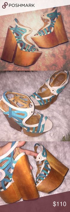 Sz.7M Jeffrey Campbell heels Hippy boho chic much? Aren't these gorgeous? Channel your inner 70's child w/these bad boys.... love themSky high comfy platform pre loved in Vic all flaws shown, some slight scuff marks on sides and back of heels. Sz.7M Jeffrey Campbell heels in a bright turquoise beautiful design... Jeffrey Campbell Shoes Platforms