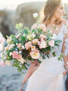 romantic beach wedding. plenty of petals florist